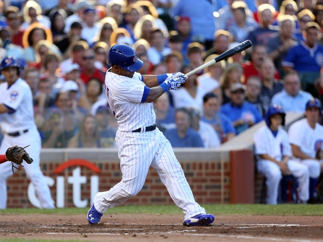 Jul 13, 2013; Chicago, IL, USA; Chicago Cubs right fielder Dave Sappelt (17) hits an RBI single during the second inning against the St. Louis Cardinals at Wrigley Field. Mandatory Credit: Dennis Wierzbicki-USA TODAY Sports