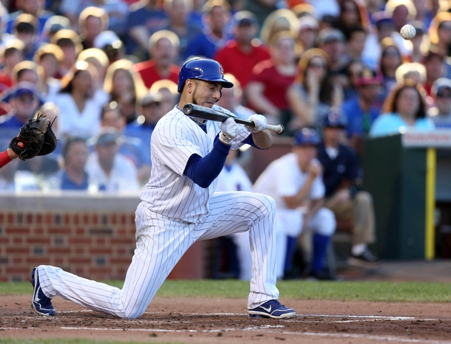 Jul 13, 2013; Chicago, IL, USA; Chicago Cubs starting pitcher Matt Garza (22) hits a bunt single during the second inning against the St. Louis Cardinals at Wrigley Field. Mandatory Credit: Dennis Wierzbicki-USA TODAY Sports