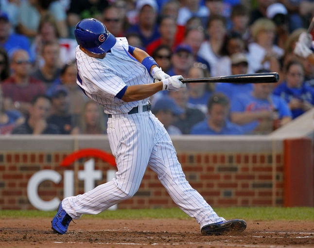 Jul 13, 2013; Chicago, IL, USA; Chicago Cubs second baseman Darwin Barney (15) hits a single during the fourth inning against the St. Louis Cardinals at Wrigley Field. Mandatory Credit: Dennis Wierzbicki-USA TODAY Sports