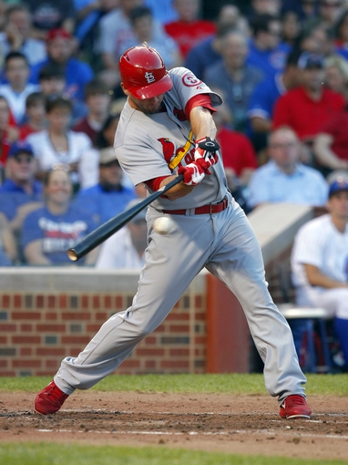 Jul 13, 2013; Chicago, IL, USA; St. Louis Cardinals third baseman David Freese (23) hits a double during the fourth inning against the Chicago Cubs at Wrigley Field. Mandatory Credit: Dennis Wierzbicki-USA TODAY Sports
