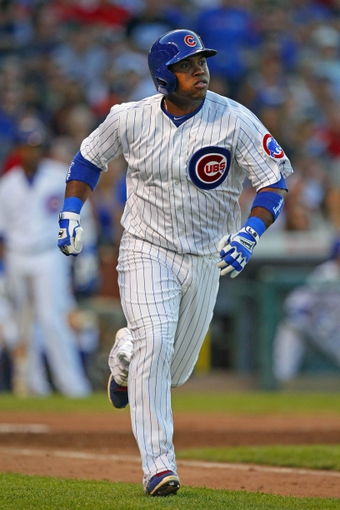 Jul 13, 2013; Chicago, IL, USA; Chicago Cubs third baseman Luis Valbuena (24) watches his 2 run home run during the fourth inning against the St. Louis Cardinals at Wrigley Field. Mandatory Credit: Dennis Wierzbicki-USA TODAY Sports