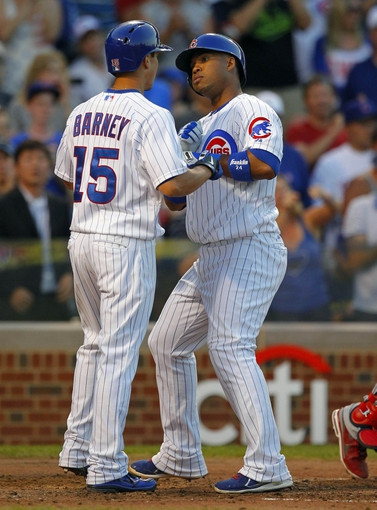 Jul 13, 2013; Chicago, IL, USA; Chicago Cubs third baseman Luis Valbuena (24) is congratulated by second baseman Darwin Barney (15) for hitting a 2 run home run during the fourth inning against the St. Louis Cardinals at Wrigley Field. Mandatory Credit: Dennis Wierzbicki-USA TODAY Sports