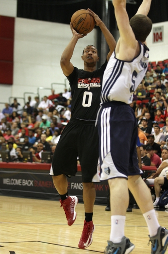 Jul 13, 2013; Las Vegas, NV, USA; Chicago Bulls guard Andrew Goudelock eyes the basket as he attempts a jump shot over defending Memphis Grizzlies forward Matt Howard during the first quarter of an NBA Summer League game at Cox Pavilion. Mandatory Credit: Stephen R. Sylvanie-USA TODAY Sports