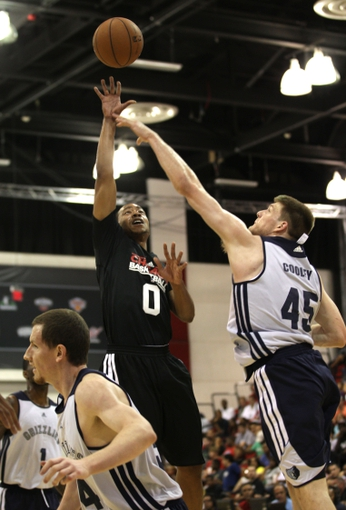 Jul 13, 2013; Las Vegas, NV, USA; Chicago Bulls guard Andrew Goudelock makes a shot attempt over the defense of Memphis Grizzlies forward Jack Cooley during the first quarter of an NBA Summer League game at Cox Pavillion. Also pictured are Memphis Grizzlies forward Matt Howard and guard Tony Wroten. Mandatory Credit: Stephen R. Sylvanie-USA TODAY Sports