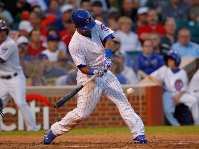 Jul 13, 2013; Chicago, IL, USA; Chicago Cubs right fielder Dave Sappelt (17) hits a single during the fifth inning against the St. Louis Cardinals at Wrigley Field. Mandatory Credit: Dennis Wierzbicki-USA TODAY Sports