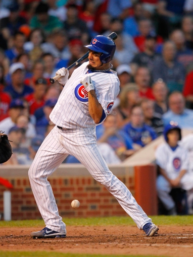 Jul 13, 2013; Chicago, IL, USA; Chicago Cubs starting pitcher Matt Garza (22) is hit by a pitch during the fifth inning against the St. Louis Cardinals at Wrigley Field. Mandatory Credit: Dennis Wierzbicki-USA TODAY Sports