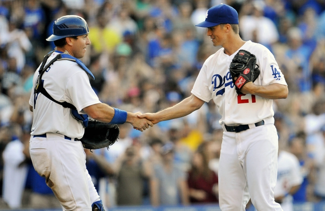 July 13, 2013; Los Angeles, CA, USA; Los Angeles Dodgers catcher A.J. Ellis (17) and starting pitcher Zack Greinke (21) celebrate the 1-0 victory against the Colorado Rockies at Dodger Stadium. Mandatory Credit: Gary A. Vasquez-USA TODAY Sports