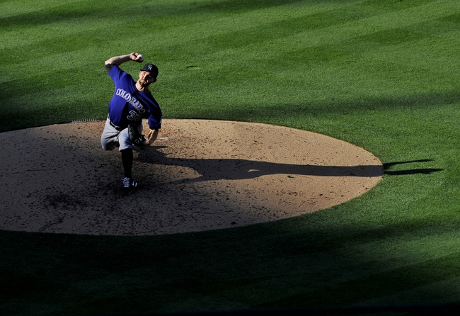 July 13, 2013; Los Angeles, CA, USA; Colorado Rockies starting pitcher Tyler Chatwood (32) pitches during the seventh inning against the Los Angeles Dodgers at Dodger Stadium. Mandatory Credit: Gary A. Vasquez-USA TODAY Sports