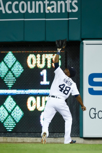 July 13, 2013; Detroit, MI, USA; Detroit Tigers right fielder Torii Hunter (48) makes a catch on a fly ball hit by Texas Rangers shortstop Elvis Andrus (not pictured) in the eighth inning at Comerica Park. Mandatory Credit: Rick Osentoski-USA TODAY Sports