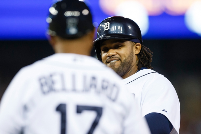 July 13, 2013; Detroit, MI, USA; Detroit Tigers first baseman Prince Fielder (28) receives congratulations from first base coach Rafael Belliard (17) after he hits a single in the eighth inning against the Texas Rangers at Comerica Park. Mandatory Credit: Rick Osentoski-USA TODAY Sports