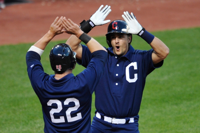 Jul 13, 2013; Cleveland, OH, USA; Cleveland Indians third baseman Lonnie Chisenhall (right) is congratulated by second baseman Jason Kipnis (22) after hitting a grand slam home run in the sixth inning against the Kansas City Royals at Progressive Field. Mandatory Credit: David Richard-USA TODAY Sports