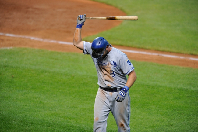 Jul 13, 2013; Cleveland, OH, USA; Kansas City Royals third baseman Mike Moustakas (8) slams his bat after fouling out in the seventh inning against the Cleveland Indians at Progressive Field. Mandatory Credit: David Richard-USA TODAY Sports