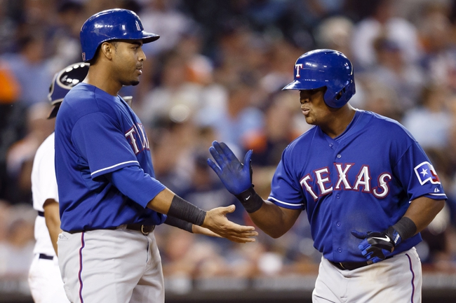 July 13, 2013; Detroit, MI, USA; Texas Rangers third baseman Adrian Beltre (29) receives congratulations from right fielder Nelson Cruz (17) after he hit a two run home run in the ninth inning against the Detroit Tigers at Comerica Park. Texas won 7-1. Mandatory Credit: Rick Osentoski-USA TODAY Sports