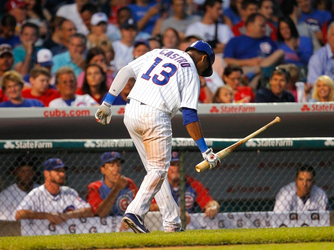 Jul 13, 2013; Chicago, IL, USA; Chicago Cubs shortstop Starlin Castro (13) reacts to striking out during the sixth inning against the St. Louis Cardinals at Wrigley Field. The Cubs won 6-4. Mandatory Credit: Dennis Wierzbicki-USA TODAY Sports