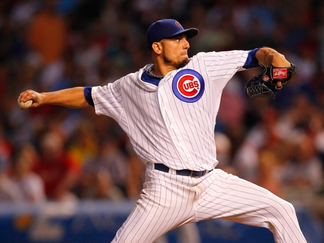 Jul 13, 2013; Chicago, IL, USA; Chicago Cubs starting pitcher Matt Garza (22) throws a pitch during the seventh inning against the St. Louis Cardinals at Wrigley Field. The Cubs won 6-4. Mandatory Credit: Dennis Wierzbicki-USA TODAY Sports