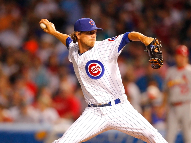 Jul 13, 2013; Chicago, IL, USA; Chicago Cubs relief pitcher Matt Guerrier (51) throws a pitch during the seventh inning against the St. Louis Cardinals at Wrigley Field. The Cubs won 6-4. Mandatory Credit: Dennis Wierzbicki-USA TODAY Sports