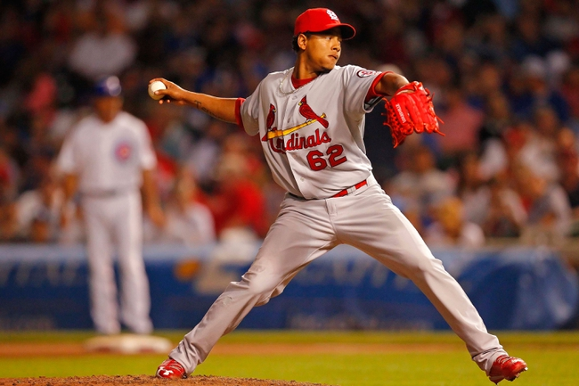 Jul 13, 2013; Chicago, IL, USA; St. Louis Cardinals relief pitcher Carlos Martinez (62) throws a pitch during the seventh inning against the Chicago Cubs at Wrigley Field. The Cubs won 6-4. Mandatory Credit: Dennis Wierzbicki-USA TODAY Sports