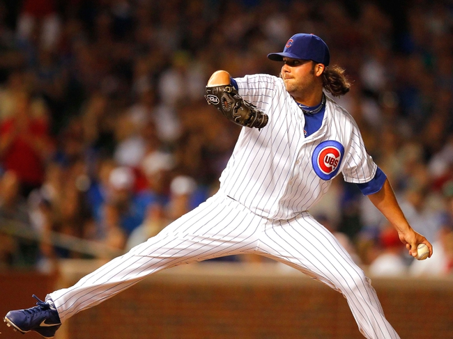 Jul 13, 2013; Chicago, IL, USA; Chicago Cubs relief pitcher James Russell (40) throws a pitch during the eighth inning against the St. Louis Cardinals at Wrigley Field. The Cubs won 6-4. Mandatory Credit: Dennis Wierzbicki-USA TODAY Sports