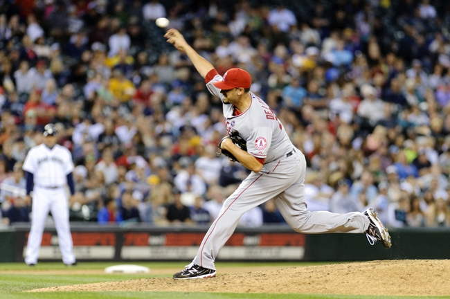 Jul 13, 2013; Seattle, WA, USA; Los Angeles Angels relief pitcher Dane De La Rosa (65) pitches to the Seattle Mariners during the 7th inning at Safeco Field. Mandatory Credit: Steven Bisig-USA TODAY Sports