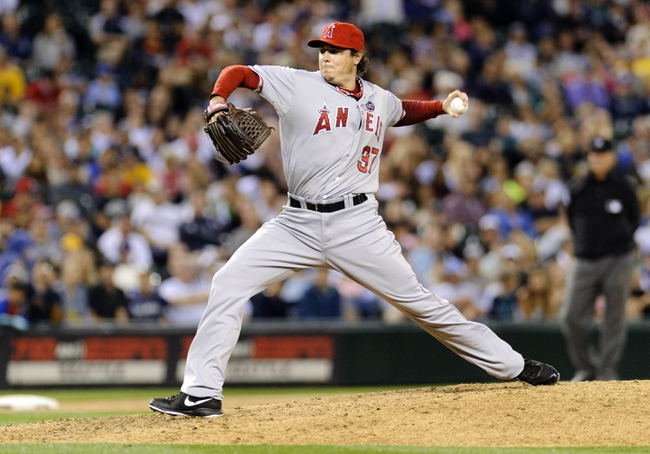 Jul 13, 2013; Seattle, WA, USA; Los Angeles Angels relief pitcher Scott Downs (37) pitches to the Seattle Mariners during the 7th inning at Safeco Field. Mandatory Credit: Steven Bisig-USA TODAY Sports