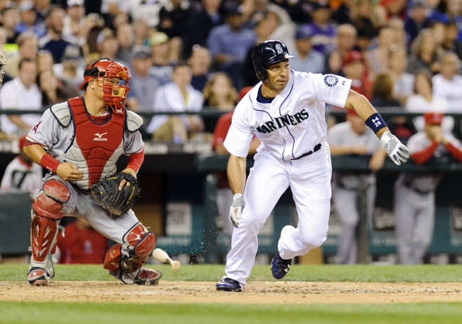Jul 13, 2013; Seattle, WA, USA; Seattle Mariners left fielder Raul Ibanez (28) runs towards 1st base after hitting a RBI single against the Los Angeles Angels during the 7th inning at Safeco Field. Mandatory Credit: Steven Bisig-USA TODAY Sports