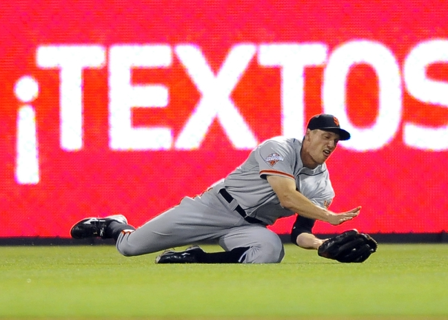 Jul 13, 2013; San Diego, CA, USA; San Francisco Giants right fielder Hunter Pence (8) makes a diving catch during the eighth inning against the San Diego Padres at Petco Park. Mandatory Credit: Christopher Hanewinckel-USA TODAY Sports
