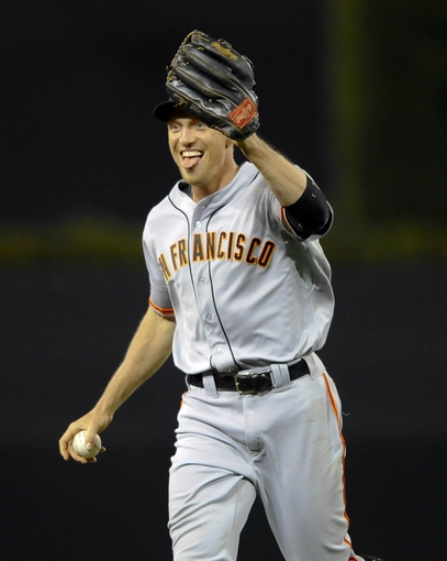 Jul 13, 2013; San Diego, CA, USA; San Francisco Giants right fielder Hunter Pence (8) reacts after a diving catch during the eighth inning against the San Diego Padres at Petco Park. Mandatory Credit: Christopher Hanewinckel-USA TODAY Sports