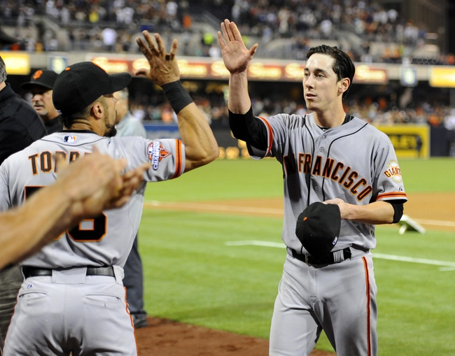 Jul 13, 2013; San Diego, CA, USA; San Francisco Giants starting pitcher Tim Lincecum (55) celebrates with teammates after throwing a no hitter against the San Diego Padres at Petco Park. The Giants won 9-0. Mandatory Credit: Christopher Hanewinckel-USA TODAY Sports