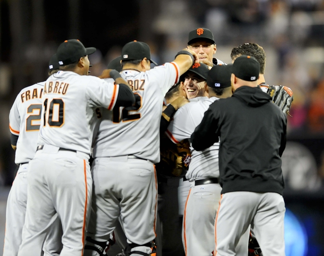 Jul 13, 2013; San Diego, CA, USA; San Francisco Giants starting pitcher Tim Lincecum (55) celebrates with teammates after throwing a no hitte