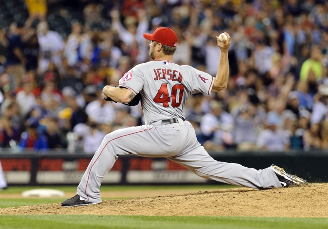 Jul 13, 2013; Seattle, WA, USA; Los Angeles Angels relief pitcher Kevin Jepsen (40) pitches to the Seattle Mariners during the 8th inning at Safeco Field. Seattle defeated Los Angeles 6-0. Mandatory Credit: Steven Bisig-USA TODAY Sports