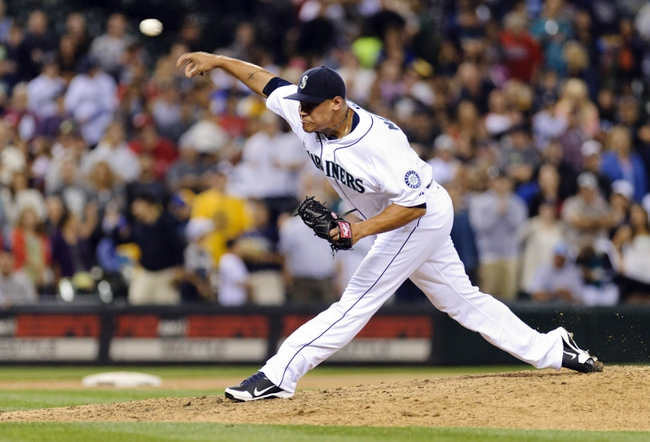 Jul 13, 2013; Seattle, WA, USA; Seattle Mariners relief pitcher Yoervis Medina (31) pitches to the Los Angeles Angels during the 9th inning at Safeco Field. Seattle defeated Los Angeles 6-0. Mandatory Credit: Steven Bisig-USA TODAY Sports