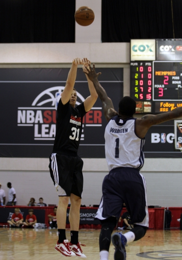 Jul 13, 2013; Las Vegas, NV, USA; Chicago Bulls guard Erik Murphy releases a jump shot over the stretched arms of Memphis Grizzlies guard Tony Wroten during the first quarter of an NBA Summer League game at Cox Pavillion. Mandatory Credit: Stephen R. Sylvanie-USA TODAY Sports