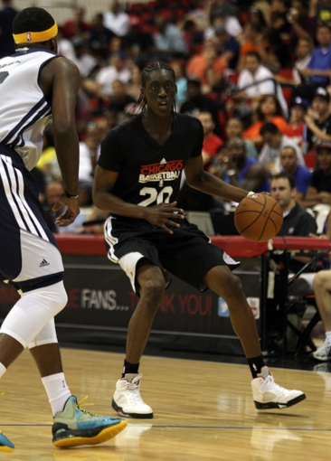 Jul 13, 2013; Las Vegas, NV, USA; Chicago Bulls guard Tony Snell dribbles while looking for an open teammate as Memphis Grizzlies forward Donte Greene approaches to defend during the first quarter of an NBA Summer League game at Cox Pavillion. Mandatory Credit: Stephen R. Sylvanie-USA TODAY Sports