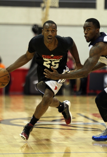 Jul 13, 2013; Las Vegas, NV, USA; Chicago Bulls guard Marquis Teague dribbles the ball around Memphis Grizzlies guard Tony Wroten during the first half of an NBA Summer League game at Cox Pavillion. Mandatory Credit: Stephen R. Sylvanie-USA TODAY Sports