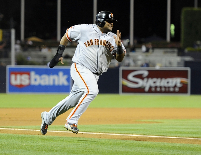 Jul 13, 2013; San Diego, CA, USA; San Francisco Giants third baseman Pablo Sandoval (48) scores on a three-run triple by right fielder Hunter Pence (not pictured) during the fifth inning against the San Diego Padres at Petco Park. Mandatory Credit: Christopher Hanewinckel-USA TODAY Sports