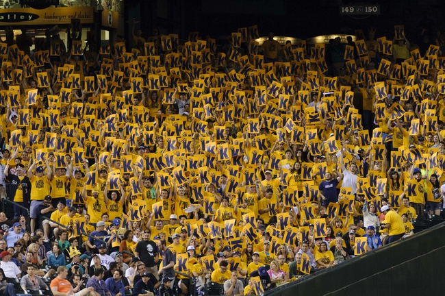 Jul 13, 2013; Seattle, WA, USA; The King's Court hold up K cards while Seattle Mariners starting pitcher Felix Hernandez (not pictured) pitches to the Los Angeles Angels at Safeco Field. Seattle defeated Los Angeles 6-0. Mandatory Credit: Steven Bisig-USA TODAY Sports