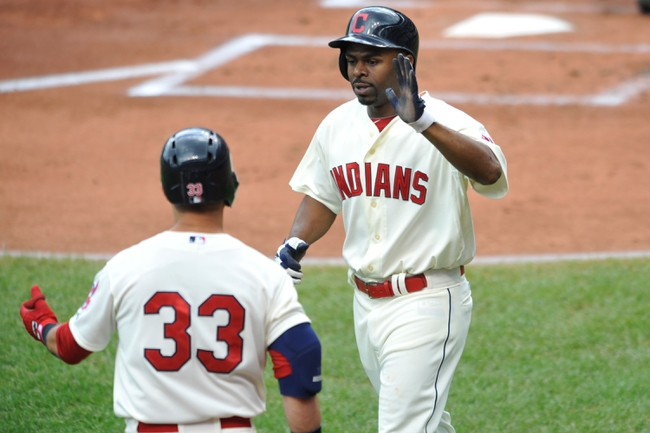 Jul 14, 2013; Cleveland, OH, USA; Cleveland Indians center fielder Michael Bourn (24) is congratulated after scoring in the first inning against the Kansas City Royals at Progressive Field. Mandatory Credit: David Richard-USA TODAY Sports