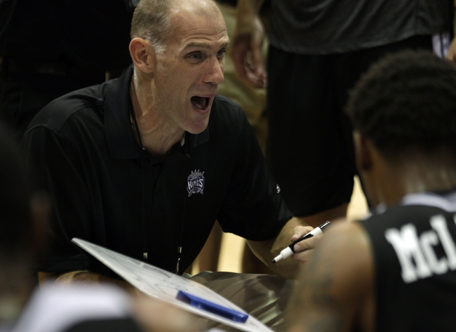 Jul 13, 2013; Las Vegas, NV, USA; Sacramento Kings assistant coach Chris Jent discusses a play during a second quarter time out of an NBA Summer League game against the Dallas Mavericks at Cox Pavillion . Mandatory Credit: Stephen R. Sylvanie-USA TODAY Sports