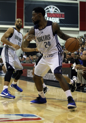 Jul 13, 2013; Las Vegas, NV, USA; Dallas Mavericks guard Terrico White (24) dribbles the ball as he looks toward Mavericks forward Jackie Carmichael (left) during an NBA Summer League game against the Sacramento Kings at Cox Pavillion. Mandatory Credit: Stephen R. Sylvanie-USA TODAY Sports