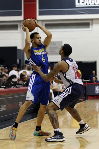 Jul 13, 2013; Las Vegas, NV, USA; Golden State Warriors guard Cameron Jones (6) controls the ball defended by Washington Wizards guard Glen Rice Jr during an NBA Summer League game at Cox Pavillion. Mandatory Credit: Stephen R. Sylvanie-USA TODAY Sports