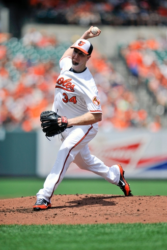 Jul 14, 2013; Baltimore, MD, USA; Baltimore Orioles starting pitcher Scott Feldman (34) throws in the first inning against the Toronto Blue Jays at Oriole Park at Camden Yards. Mandatory Credit: Joy R. Absalon-USA TODAY Sports