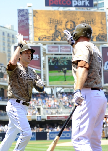Jul 14, 2013; San Diego, CA, USA; San Diego Padres right fielder Chris Denorfia (13) is congratulated by third baseman Chase Headley (7) after a home run during the first inning against the San Francisco Giants at Petco Park. Mandatory Credit: Christopher Hanewinckel-USA TODAY Sports