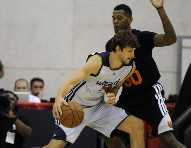Jul 14, 2013; Las Vegas, NV, USA; Washington Wizards forward Jan Vesely (left) dribbles the ball against New York Nicks forward Jeremy Tyler (right) during the an NBA Summer League game at Cox Pavillion. Mandatory Credit: Stephen R. Sylvanie-USA TODAY Sports