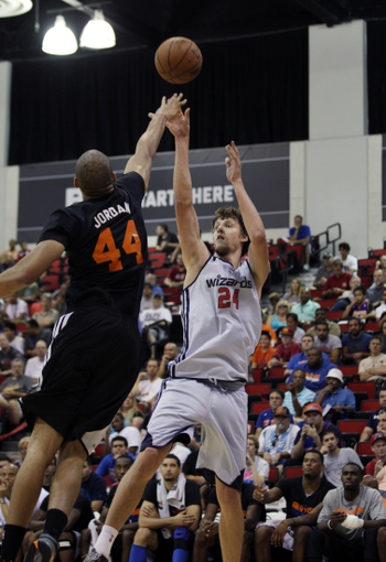 Jul 14, 2013; Las Vegas, NV, USA; Washington Wizards forward Jan Vesely (24) shoots the ball over New York Nicks center Jerome Jordan during the fourth quarter of an NBA Summer League game at Cox Pavillion. Mandatory Credit: Stephen R. Sylvanie-USA TODAY Sports