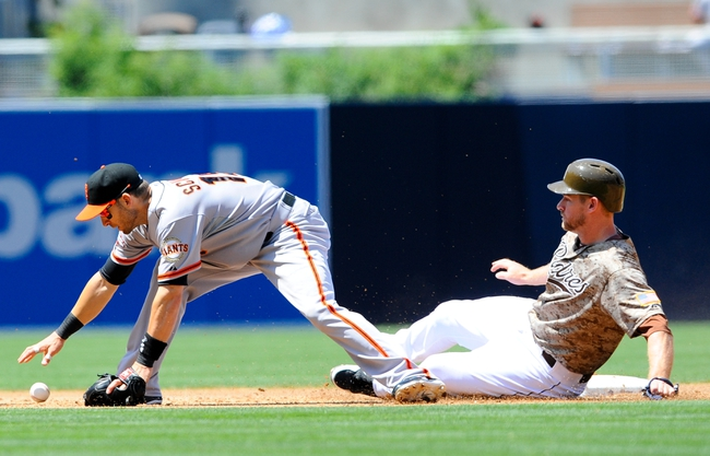 Jul 14, 2013; San Diego, CA, USA; San Francisco Giants second baseman Marco Scutaro (19) drops the ball after a force out on San Diego Padres third baseman Chase Headley (7) during the third inning at Petco Park. Mandatory Credit: Christopher Hanewinckel-USA TODAY Sports