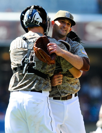 Jul 14, 2013; San Diego, CA, USA; San Diego Padres relief pitcher Colt Hynes (56) celebrates with catcher Nick Hundley (4) after a 10-1 win against the San Francisco Giants at Petco Park. Mandatory Credit: Christopher Hanewinckel-USA TODAY Sports
