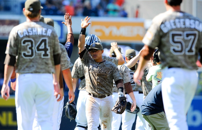 Jul 14, 2013; San Diego, CA, USA; San Diego Padres shortstop Everth Cabrera (2) celebrates with teammates after a 10-1 win against the San Francisco Giants at Petco Park. Mandatory Credit: Christopher Hanewinckel-USA TODAY Sports