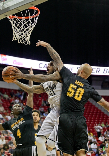 Jul 14, 2013; Las Vegas, NV, USA; Portland Trailblazers forward Thomas Robinson splits the defense of Los Angeles Lakers guard Lester Hudson and Center Robert Sacre during the first quarter of an NBA Summer League game at the Thomas and Mack center. Mandatory Credit: Stephen R. Sylvanie-USA TODAY Sports