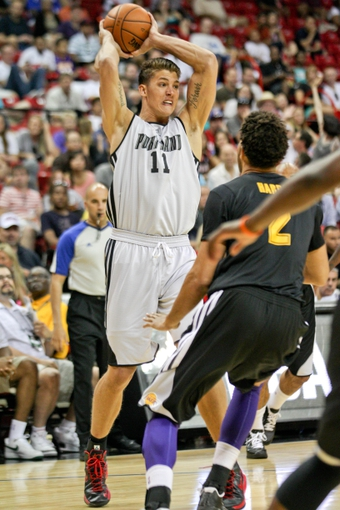 Jul 14, 2013; Las Vegas, NV, USA; Portland Trailblazers center Meyers Leonard prepares to make a pass to a teammate over Los Angeles Lakers forward Elias Harris during the first quarter of an NBA Summer League game at the Thomas and Mack Center. Mandatory Credit: Stephen R. Sylvanie-USA TODAY Sports