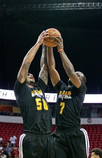 Jul 14, 2013; Las Vegas, NV, USA; Los Angeles Lakers center Robert Sacre and forward Marcus Landry both come down with a defensive rebound against the Portland Trailblazers during an NBA Summer League game at the Thomas and Mack Center. Mandatory Credit: Stephen R. Sylvanie-USA TODAY Sports